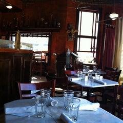 Photo taken at Cafe Saint-Ex by Elizabeth M. on 3/2/2011