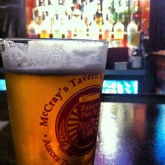 Photo taken at McCray's Tavern on the Square by Eric W. on 8/2/2012