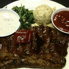 Photo taken at Holycow! Steakhouse by DiMaZ D. on 7/13/2012