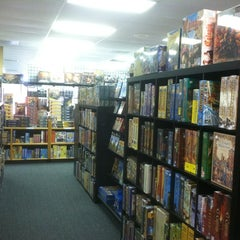 Photo taken at Madness Games and Comics by Rachel V. on 1/21/2012