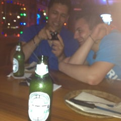 Photo taken at Hooters by Guillermo M. on 7/23/2012