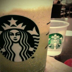 Photo taken at Starbucks by Katherina O. on 3/12/2011