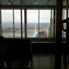 Photo taken at Gate A10 by Andrew D. on 3/5/2012