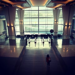 Photo taken at Gate A12 by Nobuyuki H. on 8/26/2012