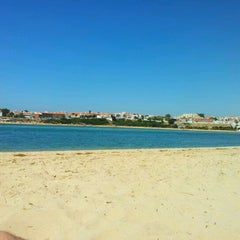 Photo taken at Praia de Vila Nova de Milfontes by Luis P. on 8/17/2011