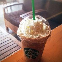 Photo taken at Starbucks (สตาร์บัคส์) by Thosaphol K. on 3/2/2012