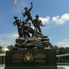 Photo taken at National Monument (Tugu Negara) by Carolyn J. on 9/23/2011