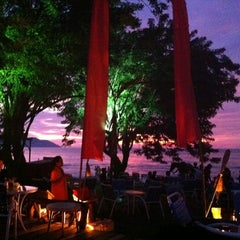 Photo taken at Batu Ferringhi Beach by Juven T. on 9/4/2011
