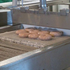 Photo taken at Krispy Kreme Doughnuts by Chris on 12/26/2011
