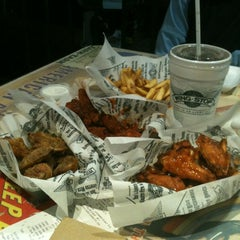 Photo taken at Wingstop by Liliana M. on 7/14/2012