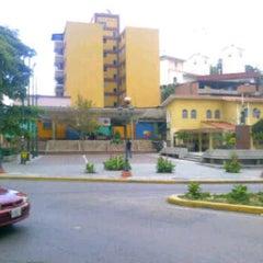 Photo taken at Plaza Bolívar by MK. on 11/16/2011