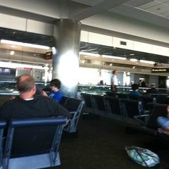 Photo taken at Gate A30 by Dan G. on 8/8/2011