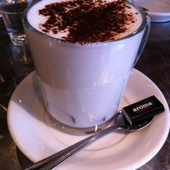 Photo taken at Aroma Espresso Bar by Bonnie L. on 3/24/2012