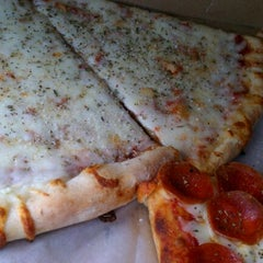 Photo taken at Slice of NY Pizza by Devin P. on 11/7/2011