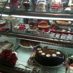 Photo taken at Café des Fleurs by Daniela B. on 5/19/2011