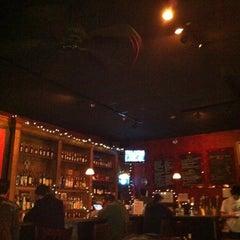 Photo taken at Rojo by Rachel S. on 1/9/2011