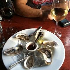 Photo taken at The Tangled Vine Wine Bar & Kitchen by Jenny S. on 8/23/2011