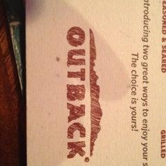 Photo taken at Outback Steakhouse by Lauren V. on 8/9/2012