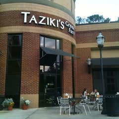 Photo taken at Taziki's Mediterrranean Cafe by Kyle W. on 4/18/2011
