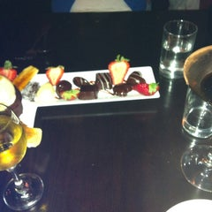Photo taken at Baileys' Chocolate Bar by Candice H. on 7/24/2012