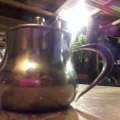 Photo taken at Three Monkeys Coffee & Tea House by Rebecca R. on 4/22/2012