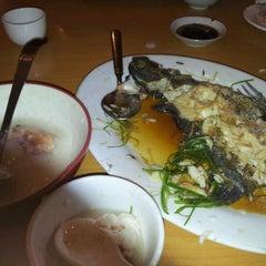 Photo taken at Laota Restaurant by Oggi I. on 3/20/2012