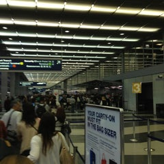 Photo taken at Terminal 3 Security Checkpoint by Brittney C. on 8/10/2012