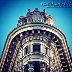 Photo taken at Flatiron Building by Kendo K. on 8/12/2012