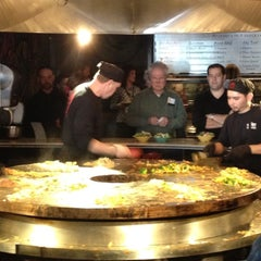 Photo taken at HuHot Mongolian Grill by John R. on 3/6/2012