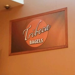 Photo taken at Tribeca Bagels by Marcus F. on 4/2/2012