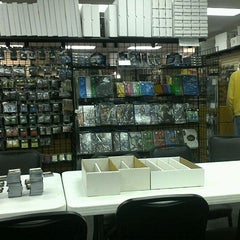 Photo taken at Madness Games and Comics by Christopher P. on 11/10/2011