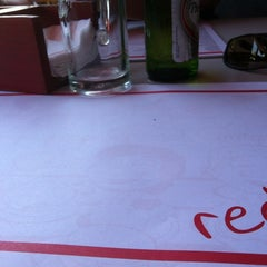Photo taken at Red Grill by Victor O. on 6/10/2012