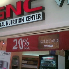 Photo taken at GNC by Alex D. on 10/3/2011
