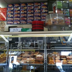 Photo taken at Tangs Doughnuts by Sam M. on 9/20/2011