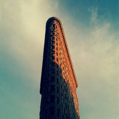 Photo taken at Flatiron Building by Doctor K. on 7/26/2012