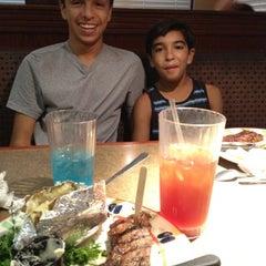 Photo taken at Sizzler Steakhouse by Gloria on 9/1/2012