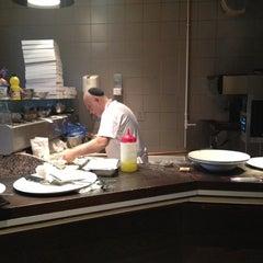 Photo taken at Momento Café by Herve K. on 12/8/2011