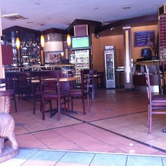 Photo taken at Lugz Indian Cuisine by Justin R. on 9/25/2011