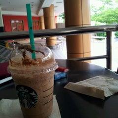 Photo taken at Starbucks by McD0nalds' INC on 3/2/2012