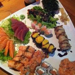 Photo taken at Hanbai Sushi Bar by Vinicius G. on 9/12/2012
