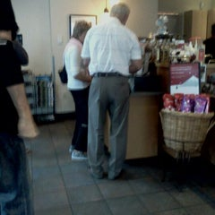 Photo taken at Starbucks by Charity A. on 12/9/2011