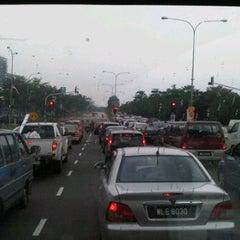 Photo taken at Traffic Light Gate UiTM Seksyen 7 by Awal S. on 9/26/2011
