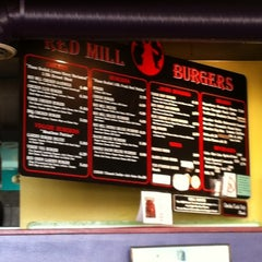 Photo taken at Red Mill Burgers by Richard M. on 3/1/2012