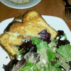 Photo taken at Home Grown Cafe by Stephanie H. on 1/17/2012