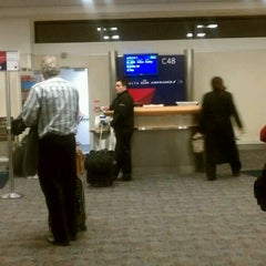 Photo taken at Gate C48 by Shawn C. on 2/10/2012