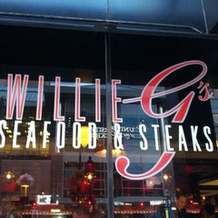 Photo taken at Willie G's Seafood & Steakhouse by Rob R. on 7/19/2012