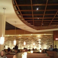 Photo taken at California Pizza Kitchen by Brent P. on 12/9/2011