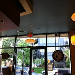 Photo taken at Infuzion Cafe by Jeannie N. on 3/29/2012