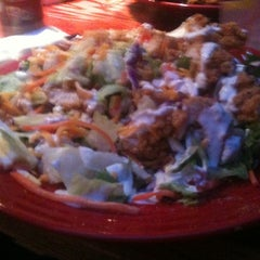 Photo taken at Red Robin Gourmet Burgers by Anh V. on 12/20/2011