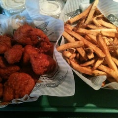 Photo taken at Wingstop by Lindsey C. on 4/1/2011